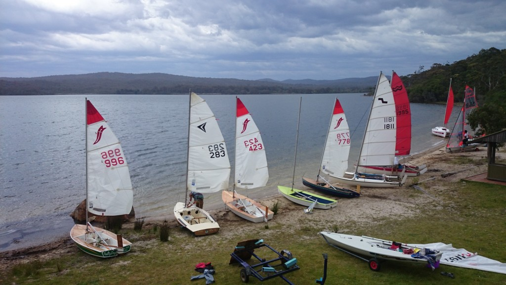 OMINOUS WEATHER: A fleet of boats rigged up for sailing on Wallagoot lake, despite the threatening clouds.