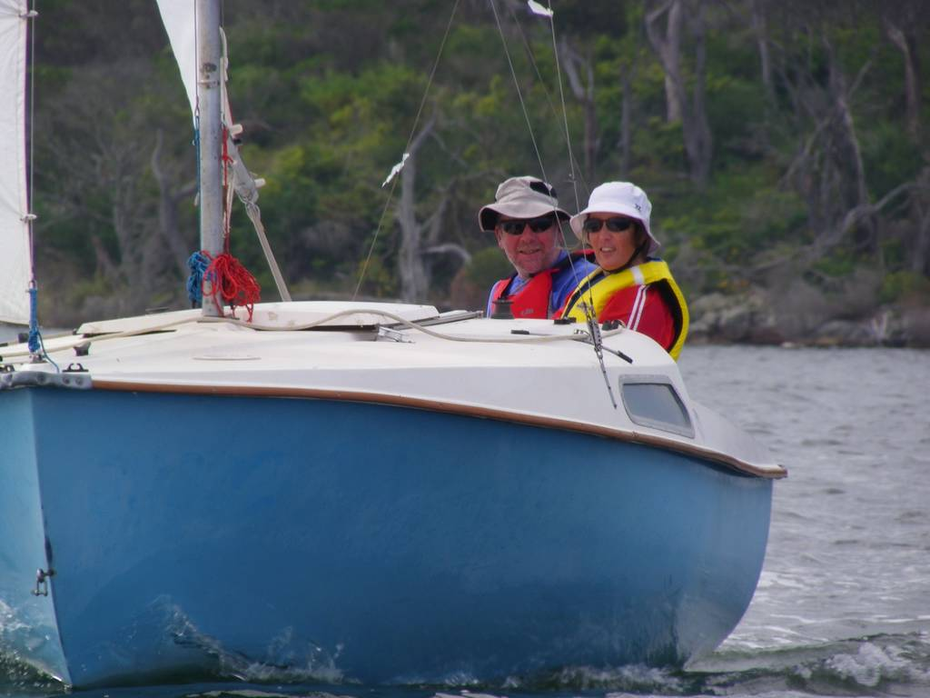 Ian and Aimee Curtis on their Denis trailer-sailor