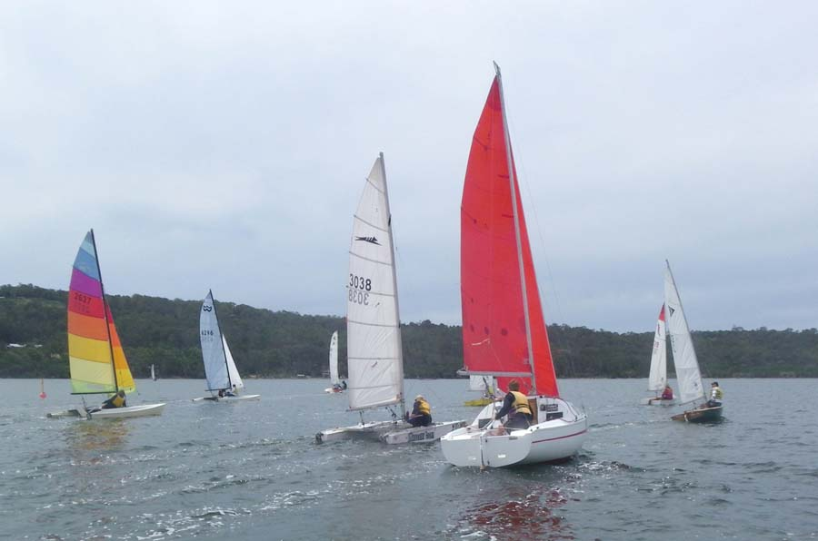 The fleet sails away from the start line