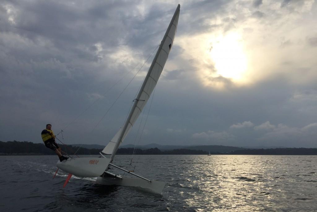 As the sun began to set on the sailing season, Darren Lydiard flew across Wallagoot Lake to a glorious win.
