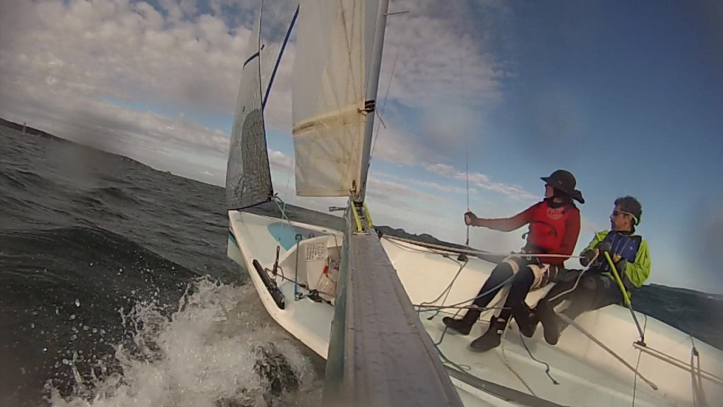 Skipper Tony Hastings and crew Luca Dorrough racing through ocean swells on Batemans Bay
