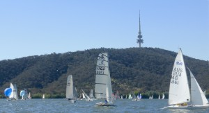 Sail number 1705 is the NS14 of Tony Hastings and Luca Dorrough, sailing through a fleet of 72 boats on Lake Burley Griffin.