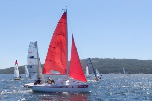 Brian Wright crosses behind the fleet on port tack, just after the start of race one