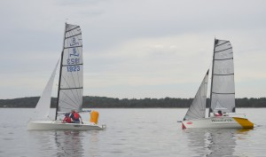 Josh and Jarrah Dorrough drift across the line a boat length ahead of Rob and Sian Morton to win race two
